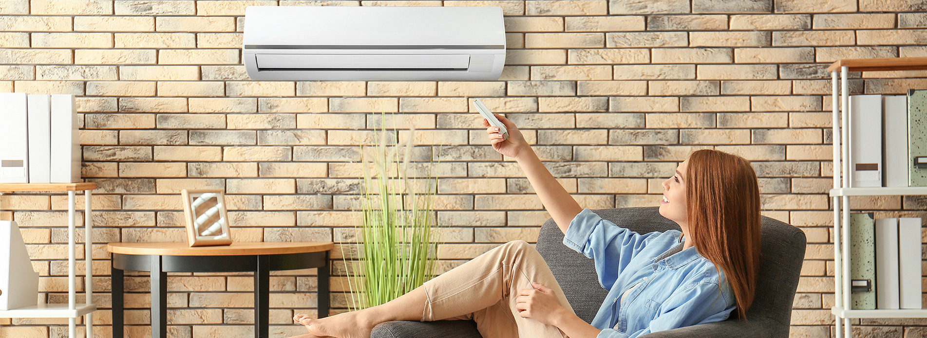 Woman enjoying an ac system in her living room